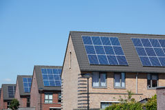 Ouses with solar panels on the roof for alternative energy Stock Image
