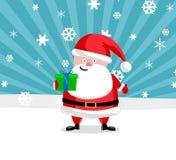 Ouside de Santa avec un présent Photos stock