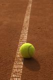 Out?-2. The tennis ball lie near the line Royalty Free Stock Image