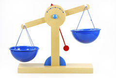 Out of balance. Wooden toy scales out of balance Royalty Free Stock Image