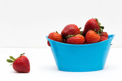 Out of Basket. A strawberry out of basket Stock Image