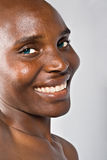 Out of the blue. Hairless beautiful African woman, cancer patient after chemotherapy Royalty Free Stock Photo