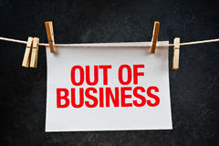Out of business note printed on paper Royalty Free Stock Images
