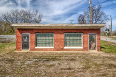 Out Of Business Store. An abandoned small store sits in disrepair Royalty Free Stock Images