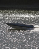 Out Of Control. Run away boat on river Royalty Free Stock Photo