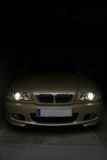 Out of the dark. Golden sportscar peeking out of the dark stock image
