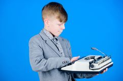 Out of date. I need modern gadget instead this retro. Outdated gadget. Retro and vintage. Yard sale. Retrospective study. Boy hold retro typewriter on blue stock image