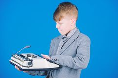 Out of date. I need modern gadget instead this retro. Outdated gadget. Retro and vintage. Yard sale. Retrospective study. Boy hold retro typewriter on blue royalty free stock photography