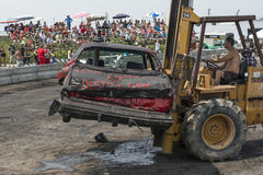Out of demolition derby. Napierville demolition derby, July 12, 2015, picture of wrecked car go out during the demolition derby royalty free stock image