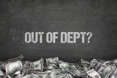 Out of dept text on black background. With dollar pile royalty free stock photography
