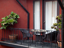 Out door balcony. Table and armchair at out door balcony Stock Photography