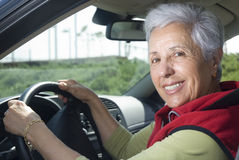 Out for a drive. Happy senior woman out for a drive Royalty Free Stock Image