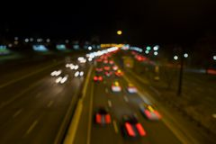 Out of focus abstract night city street. Long exposure. stock photo
