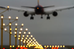Out of focus airliner and runway lights Stock Images
