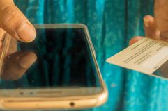 Out of focus Asian and Indian woman paying bill at home with online payment technology via internet, with plastic credit card and royalty free stock photos