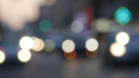 Out of focus background with blurry unfocused city lights. City at night background with cars. Out of focus background with blurry unfocused city lights stock footage