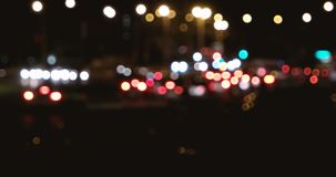 Out of focus background with blurry unfocused city lights and driving cars. With defocused car lights. Commuters in the evening go home stock video footage