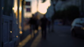 Out of focus background and unrecognizable people walking around the city stock footage