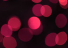 Out of focus, Blurred, Bokeh Vibrant Pink Light on Black for abstract background Royalty Free Stock Images