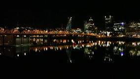 Out of Focus Bokeh of Portland Oregon Downtown City Skyline and Hawthorne Bridge with Water Reflection at Night 1080p stock video footage