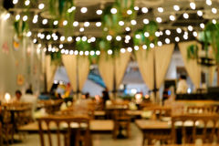 Out of focus cafe restaurant with people relaxing and enjoying food Royalty Free Stock Photos