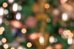 Out of focus christmas tree. Xmas ball with a out of focus christmas tree in the background Royalty Free Stock Photos