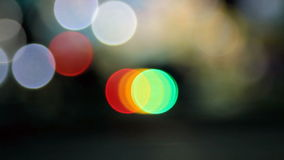Out of focus colorful balls of light moving from left to right. stock video footage