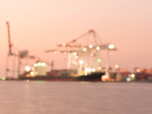 Out of focus  Containers loading by crane in the evening , Trade. Port , Shipping Royalty Free Stock Photos