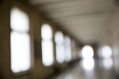 Out of focus corridor. In an old building. Light coming from outside through the windows Royalty Free Stock Photo