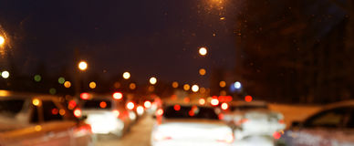 Out of focus lights of urban traffic in a city Royalty Free Stock Photo