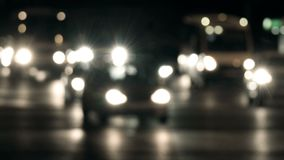 Out of focus lights of urban traffic in nighttime. Night life of big city.  stock video footage
