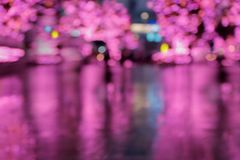 Out of focus picture of a rainy city scene at night. Royalty Free Stock Photo