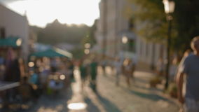 Out of focus scene of crowded street. People walking down the street in the evening, beautiful light at sunset. Footage made out of focus, no faces are stock footage
