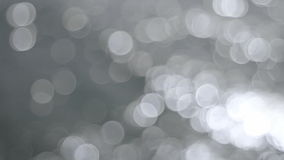 Out of Focus Silver Bokeh Circle Dots of Glistening Water Background Movie 1080p stock video