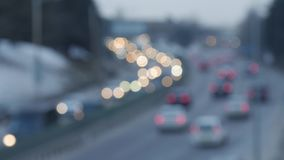 Out of focus traffic lights of cars on the sreet. stock footage