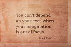 Out of focus Twain. You can`t depend on your eyes when your imagination is out of focus - famous American writer Mark Twain quote printed on vintage grunge paper Stock Photos