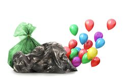 Out of the garbage bag are fly balloons. Stock Photos