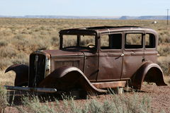 Out Of Gas. A rusty old antique car, set in a field of dry grasses near historic Route 66 in northeastern Arizona Stock Photography