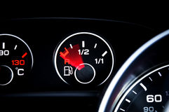 Out of gas. Empty fuel gauge on a black dashboard royalty free stock photo