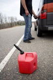 Out of gas. Out on a rural road with gas container royalty free stock image