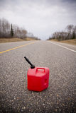 Out of gas. Out on a rural road with gas container stock images
