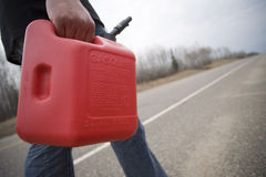 Out of gas. Out on a rural road with gas container royalty free stock images