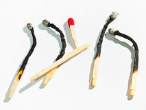 Out of harm's way. Matchsticks on white underground to full size format Stock Photos