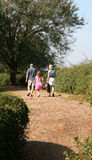 Out for a Hike. Small family walking on a path stock image