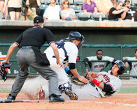 Out at Home. RiverDogs catcher Radley Haddad tags out Hickory Crawdads baserunner Luke Tendler at home plate stock photo