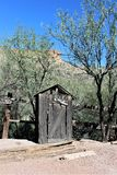 Tortilla Flat, small unincorporated community in eastern Maricopa County, Arizona, United States. Out house structure in Tortilla Flat Town in a small royalty free stock photos