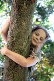 Out on a limb. Child climbed into a tree and was looking down at the person taking her picture Royalty Free Stock Photo