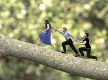 Out on a limb and team work. Composite image depicting the `Out on a limb` and team work concepts using 3D figure renders royalty free stock photography