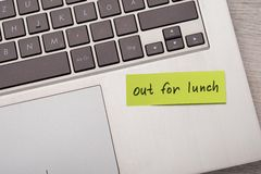Out for lunch sticky note on laptop Stock Photography