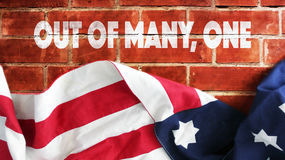 Out Of Many, One. USA Flag And Bricks Stock Photography